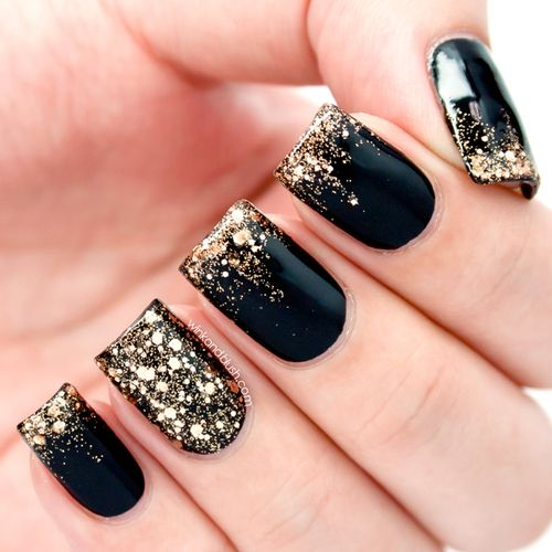 Black polish with gold sparkles
