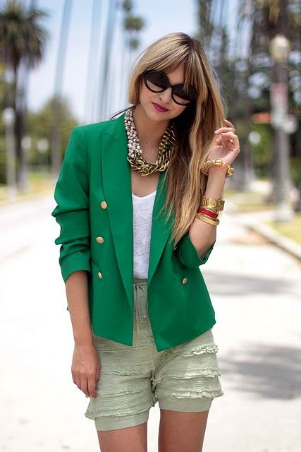 Gold statement necklace with green blazer