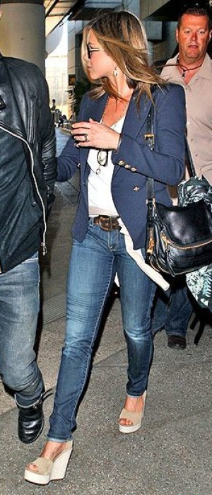 Jennifer Aniston is totally committed to comfort on her transcontinental jaunts, hence her affinity for these Pedro García wedges