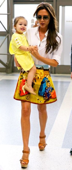 Victoria Beckham wore Carven's multicolor renaissance printed velvet skirt and brown Chloe wedges