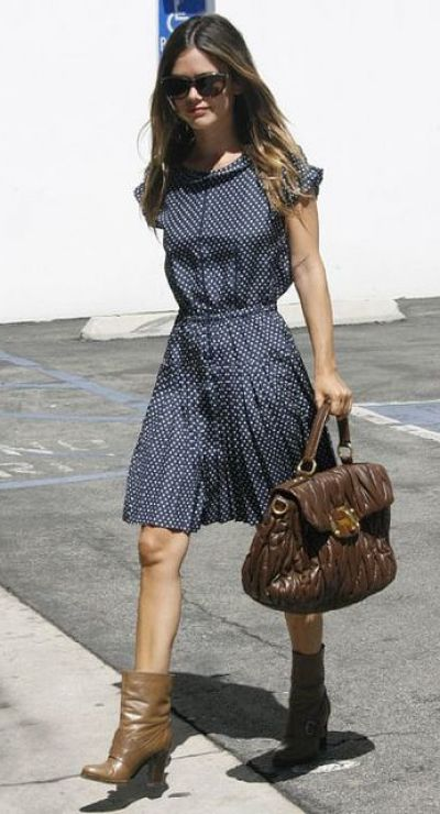 Rachel Bilson looking gorgeous wearing a Polka dot dress, ankle boots and brown Miu Miu handbag