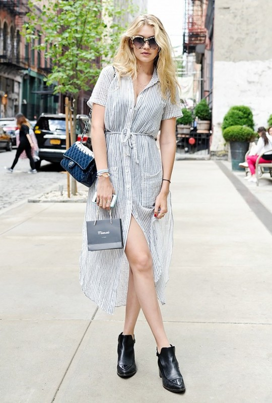 Gigi Hadid styles pointed-toe ankle boots with a ladylike dress for a cool contrast.
