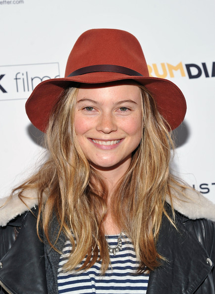 Boho waves and a floppy hat play up Behati Prinsloo's youthful nature.