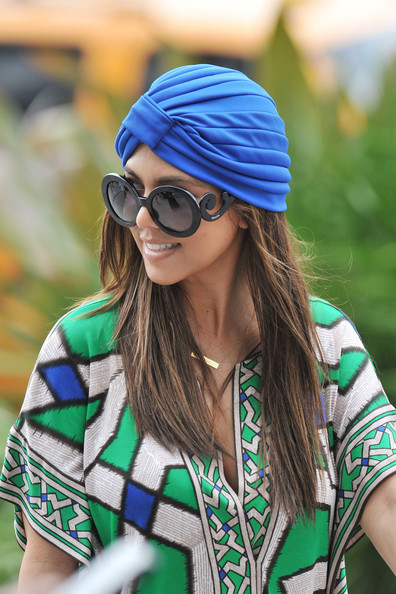 Hide frizzy hair with a bright turban like this one Kourtney Kardashian chose.