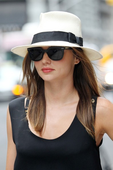 Miranda Kerr added the appearance of volume to her strands with a wide-brimmed hat in a tall silhouette.