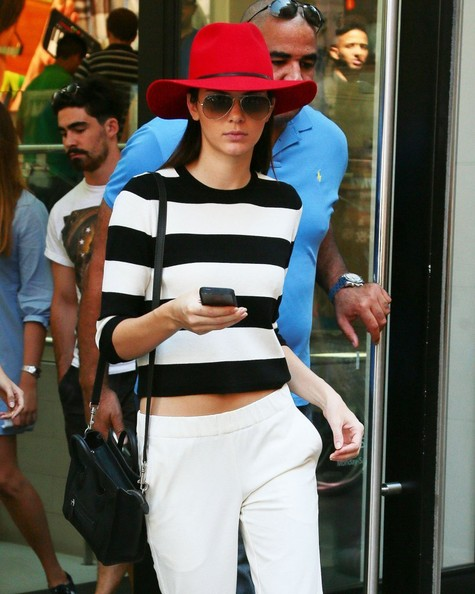 To add volume and interest to long straight hair, take a page from Kendall Jenner's style book and try a wide-brimmed hat in a bold hue.