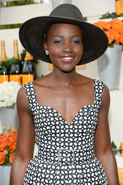 Women with short hair like Lupita Nyong'o's don't need to fear hats. A big statement topper can replace a time-consuming hairstyle.