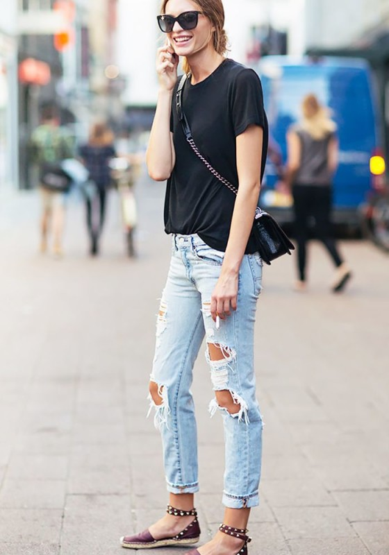 A black t-shirt is worn with boyfriend jeans, ankle-strap espadrilles, crossbody Chanel bag, and black sunglasses