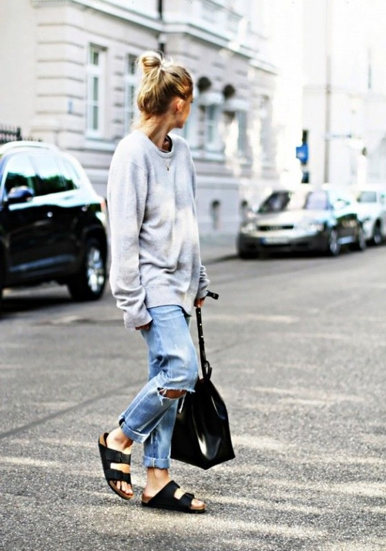 A gray sweater is paired with boyfriend jeans, Birkenstocks, and a Mansur Gavriel bucket bag