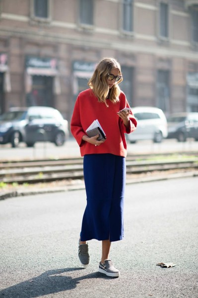 Candela Novembre This combination of red top and blue midiskirt makes primary colors look polished, especially with houndstooth sneakers.