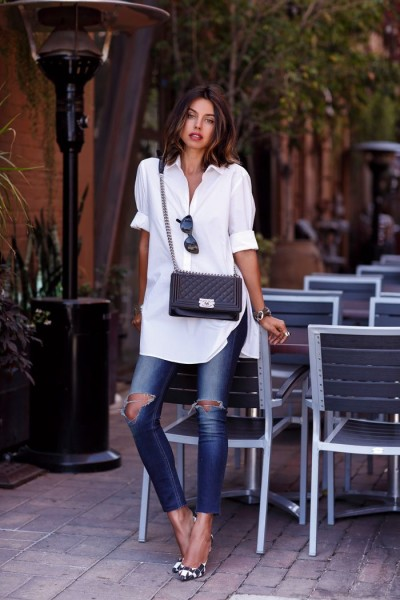 white long shirt + cat eye sunglasses + black quilted crossbody bag + dark denim skinnies + black and white geometric print stilettos