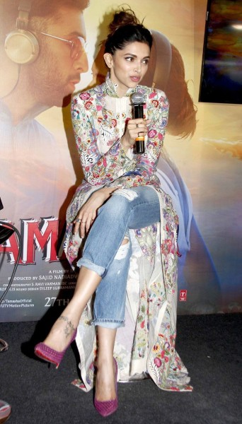 Deepika Padukone interacting with the media while celebrating the success of Tamasha's music.
