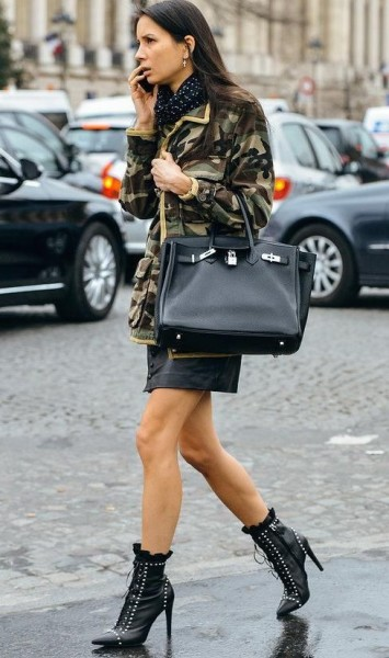 Camo jacket, mini skirt, studded black booties and black Birkin bag