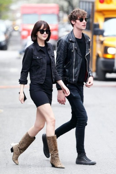 Dakota Johnson was photographed in New York City wearing a little black dress, a cropped jean jacket, and cheetah-print boots, with a one-of-a-kind accessory  in a color-coordinated outfit.