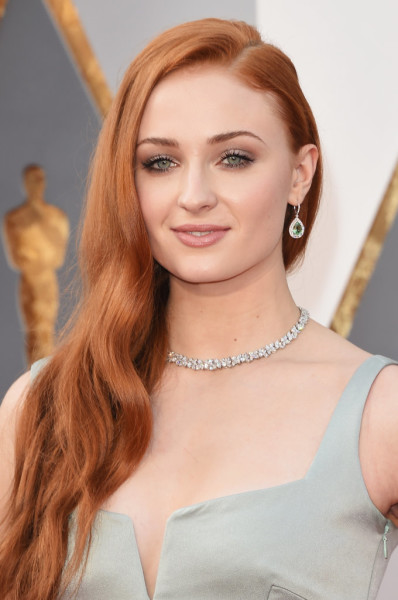 Sophie's gorgeous red hair was styled in loose, casual waves.