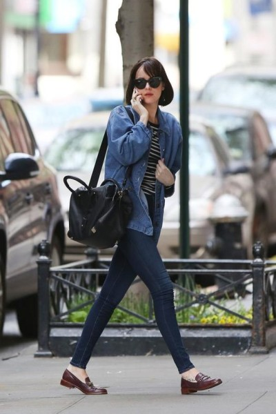 dakota johnson, loafers, jean jacket, black and gray striped shirt,