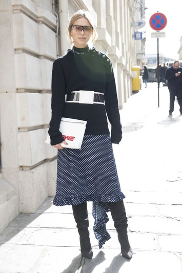 With a midi skirt and sweater