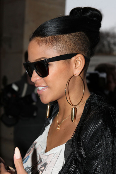 For a casual look that reveals all, Cassie piled her strands on top of her head in a stylish top knot.