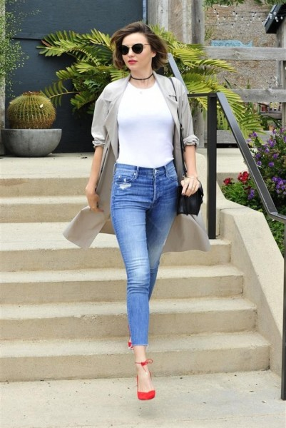 Miranda Kerr was seen embracing the casual uniform while out in Los Angeles. The Aussie paired her cropped skinnies with a plain white tee, a lightweight trench, and red pumps