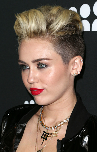 Never one to back away from making a statement, Miley Cyrus gave her 'do some major height.