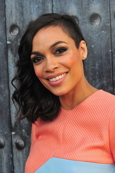 To balance out the masculine nature of the shaved look, Rosario Dawson added some feminine curls to her hair.