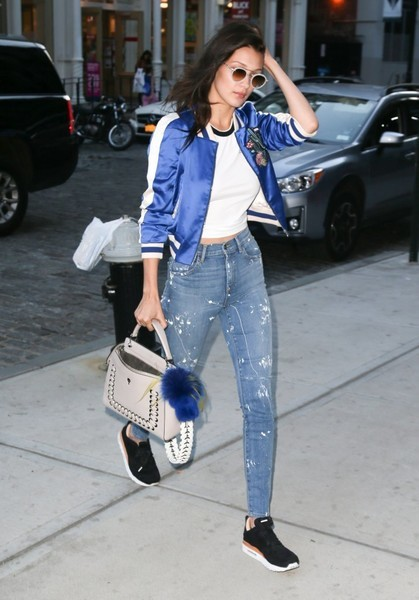 Bella Hadid rocked a pair of paint-splattered skinny jeans by Made Gold.