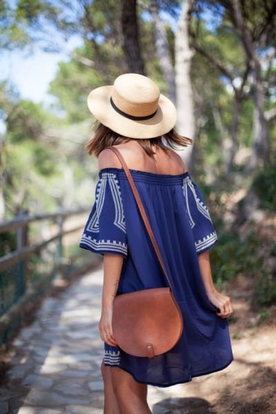Blue embroidered off shoulder dress and tan leather saddle bag