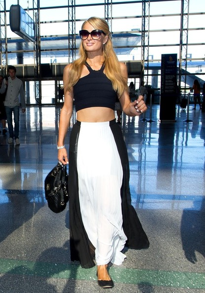 Paris Hilton and River Viiperi prepare to depart LAX (Los Angeles International Airport). Paris shops at the store In-Motion before going through security.