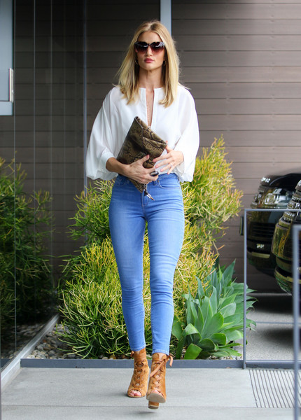 Rosie Huntington-Whiteley looked enviably slim in her Paige jeans as she headed to her office.
