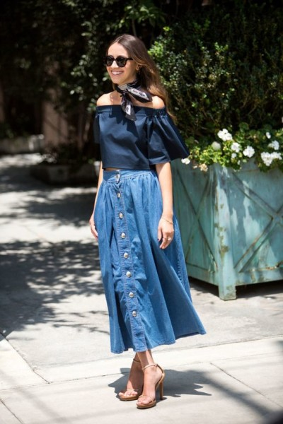 Style your denim midi skirt with an off-the-shoulder top and a neck scarf for added volume