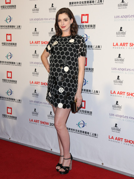 Anne Hathaway showed off her cute maternity style with this Marc by Marc Jacobs dotted mini dress at the LA Art Show opening.