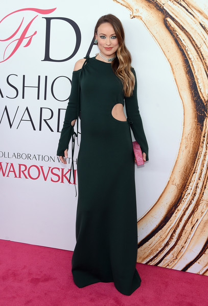 Olivia Wilde showed off her funky maternity style in this dark green cutout gown by Rosie Assoulin at the 2016 CFDA Fashion Awards.