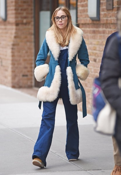 Suki Waterhouse worked a groovy '70s vibe in a blue and white fur-trimmed coat layered over flared overalls while out and about in Tribeca.