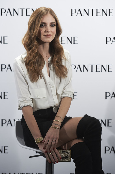 Chiara Ferragni added more bling with a trio of gold bangles.