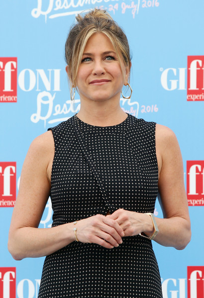 Jennifer Aniston attended the Giffoni Film Festival wearing a geometric gold bangle.
