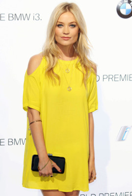 Laura Whitmore and gold bangle around the forearm is a unique way to spice up your accessories.