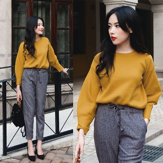 Mustard sweater and grey harem pants.
