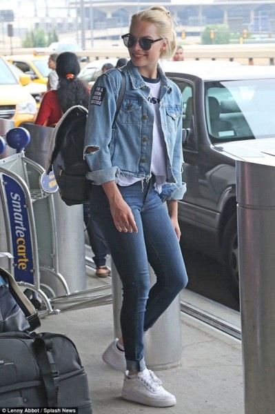 Suicide Squad's Margot Robbie has debunked the idea that double denim should be avoided at all costs when she was spotted arriving at Newark