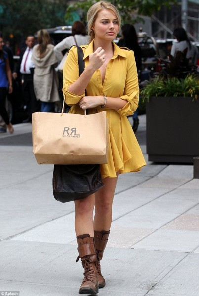 This bright yellow dress paired up with brown leather boots scream major country vibes though it also has a bit of a vintage feel to it.