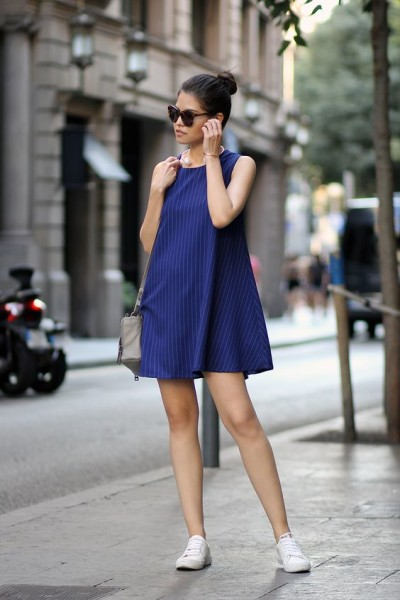 Vertical striped A-line dress and simple white sneakers.