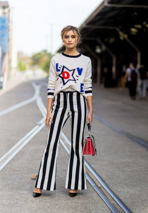 A graphic knit with striped flares makes a bold statement when paired with a structured bag and pumps