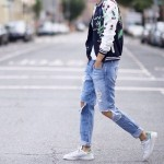 Embellished bomber jacket, white tee, ripped jeans, white sneakers