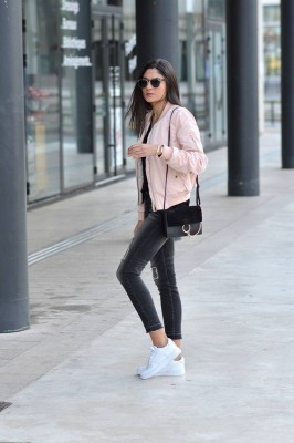 Federica L. wears the bomber jacket trend in a pretty shade of pale pink, capturing casual and feminine vibes in her every day outfit.