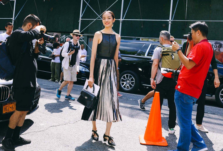 Fei Fei Sun in a Proenza Schouler dress, shoes and bag
