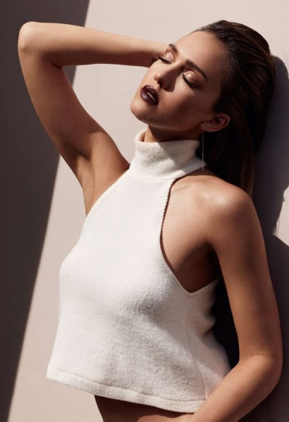 Jessica Alba wears a white sleeveless mock neck top