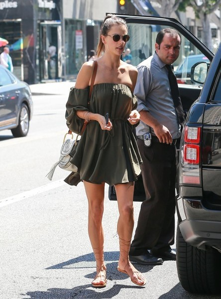 Alessandra Ambrosio stayed cool and cute in a military-green off-the-shoulder dress for a lunch out in West Hollywood.