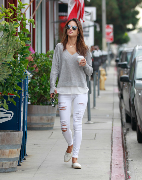 Alessandra Ambrosio went on a coffee run dressed down in a loose gray V-neck sweater.