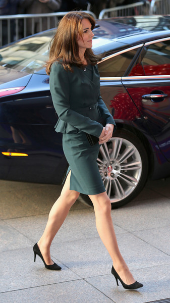 Kate Middleton kept it classy in a forest-green L.K.Bennett skirt suit with peplum detailing at the ICAP Charity Day event.