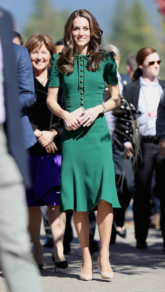 Kate Middleton looked fetching in a green Dolce & Gabbana midi dress with gold buttons and bow detailing while touring Canada.