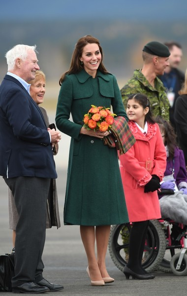 Kate Middleton stayed warm in a stylish green trenchcoat by Hobbs while touring Canada.